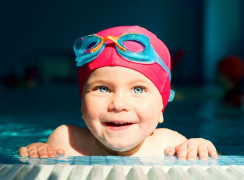 child in red swimming cap